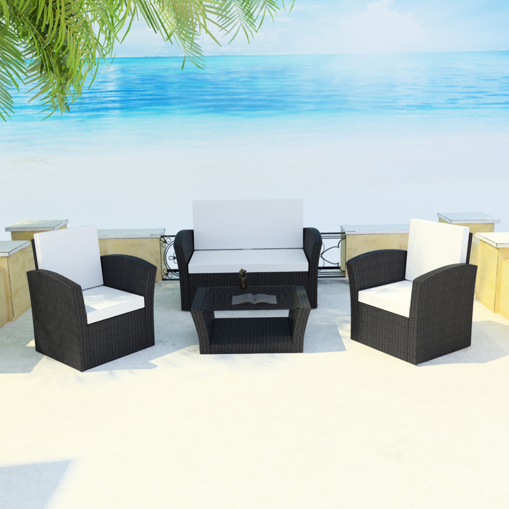 garden set with pillows sitting in black polirattan